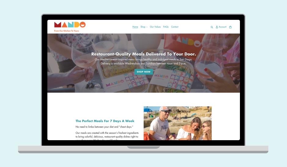 Mando's website displayed on laptop mockup